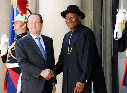 PRESIDENT FRANCOIS HOLLANDE OF FRANCE (L), WELCOMING PRESIDENT GOODLUCK JONATHAN TO THE PARIS SUMMIT