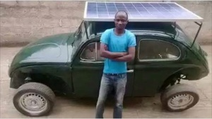 Segun Oyeyiola poses with his locally fabricated solar powered car