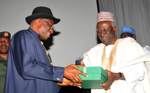 President Jonathan receiving the Report of the 2014 National Conference from Justice Idris Kutigi today in Abuja