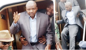 Governor Danbaba Suntai, assisted by officials to disembark from an aircraft on his return after treatment abroad