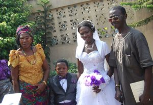 Chinedu Ikedieze with his wife's parent, Mr and Mrs Nwaijah Lawrence